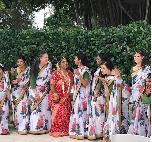 Sari draping bridal party in indian wedding