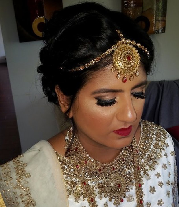 indian bride with makeup and hair done for bhavii brides wedding