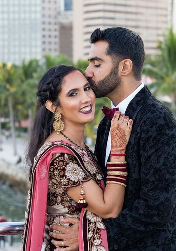 bride and groom at Indian wedding in Fort Lauderdale with bridal henna and hair